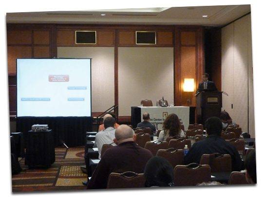 A photo of Uwe Muegge, Chief Terminologist and Co-Director of MedL10N, presenting at CMS/DITA North America 2011.