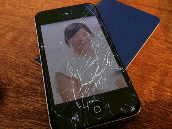A picture of an iPhone with broken glass.